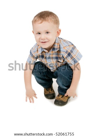 Portrait of the two-year blue-eyed boy in a chequered shirt, isolated on white - stock photo