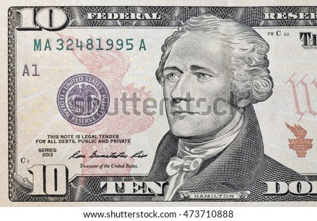 Portrait of the US President Alexander Hamilton on ten dollar banknote bill, front side obverse, macro