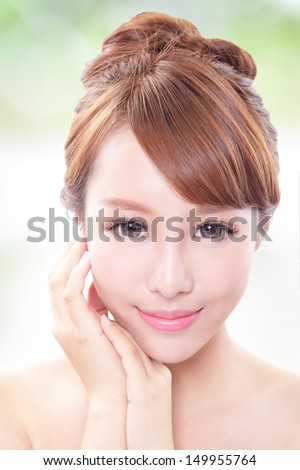 portrait of the woman with beauty face and perfect skin isolated on green background, asian model - stock photo