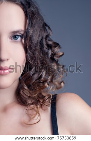 Portrait of the young attractive woman with curly hair