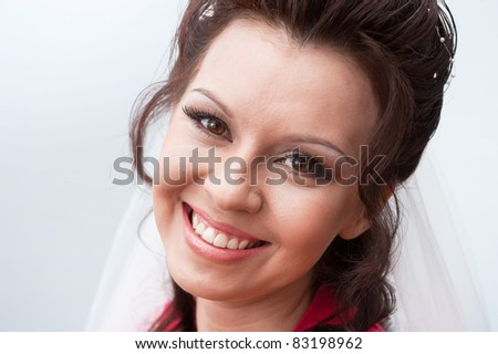 Portrait of the young beautiful bride on a grey background - stock photo