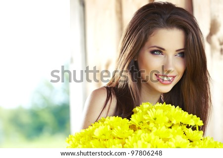 Portrait of the young beautiful smiling woman outdoors - stock photo