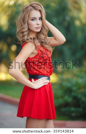 Portrait of the young beautiful smiling woman outdoors enjoying summer sun. Young woman outdoors portrait. Beautiful blonde woman outdoor - stock photo