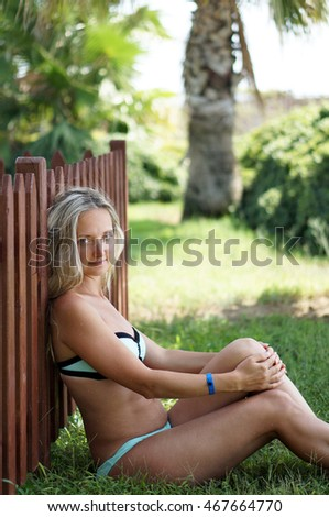 Portrait of the young beautiful woman outdoors