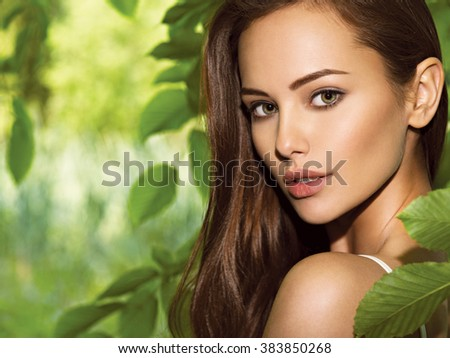portrait of the young beautiful woman with long hairs. outdoors.