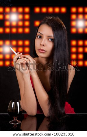 Portrait of the young girl having a rest at restaurant, cafe, a bar