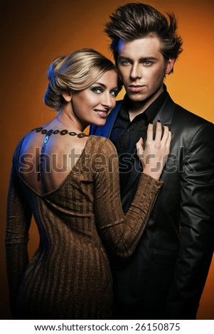 Portrait of the young handsome couple - stock photo