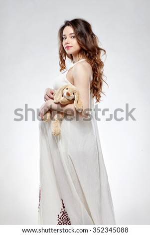 Portrait of the young happy smiling pregnant woman - stock photo