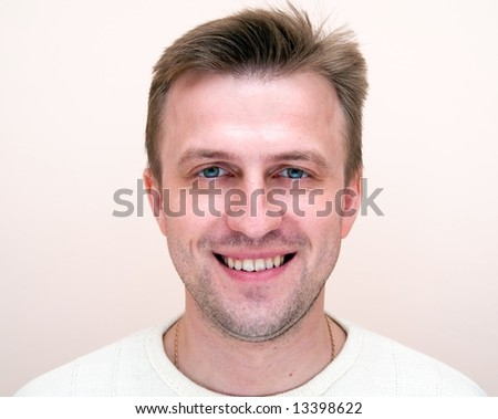 Portrait of the young smiling man. Face close up.