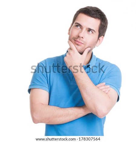 Portrait of the young thinking man looks up with hand near face -  isolated on white. - stock photo