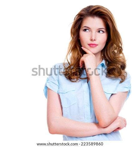 Portrait of the young thinking woman looking up sideways- isolated on white background. - stock photo