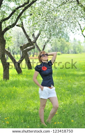 Portrait of the young woman against the nature of spring