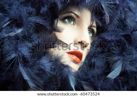 Portrait of the young woman from a boa - stock photo