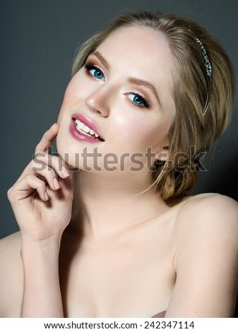 Portrait of the  young woman who smiles - stock photo