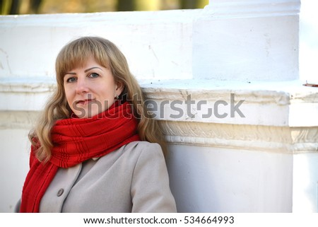 Portrait of the young woman with a red scarf