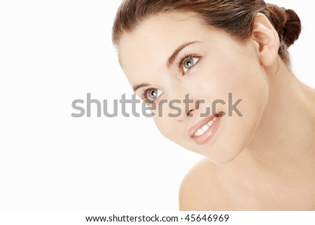 Portrait of the young woman with the well-groomed face skin, isolated - stock photo