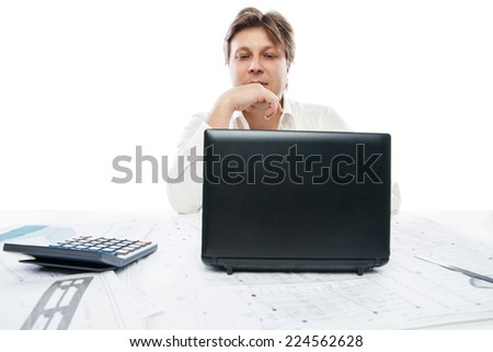 Portrait of thinking young office worker with laptop isolated on white