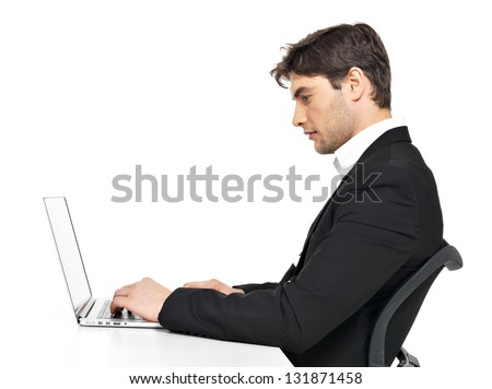 Portrait of thinking young office worker with  laptop sitting on the table  isolated on white.