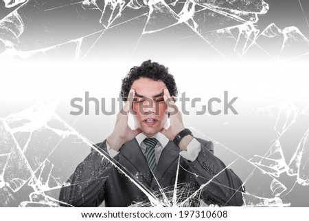 Portrait of thoughtful business man with headache standing behind broken glass, Stressed businessman trying to concentrate while having headache - stock photo