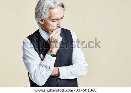 Portrait of thoughtful businessman - stock photo
