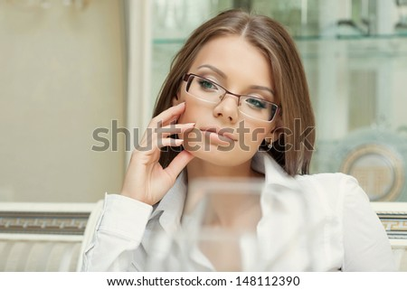 Portrait of thoughtful charming woman in glasses - stock photo