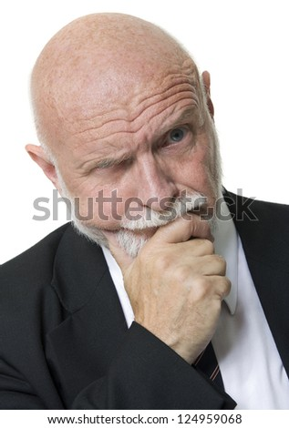 Portrait of thoughtful elderly businessman