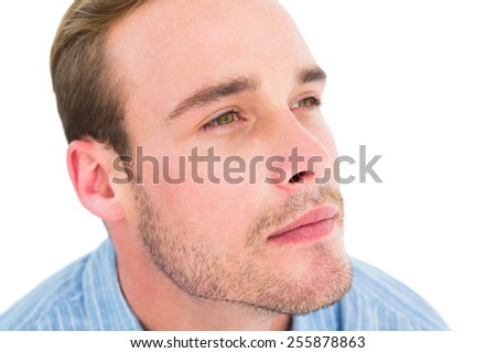 Portrait of thoughtful man looking away on white background