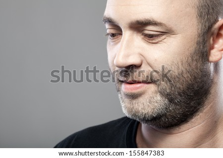 portrait of thoughtful mature caucasian man isolated on gray background with copyspace