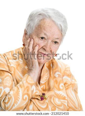 Portrait of thoughtful  old woman on a white background - stock photo