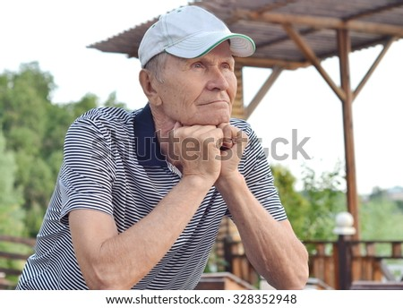 portrait of thoughtful senior man - stock photo