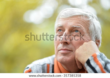 Portrait of thoughtful senior man  in  park