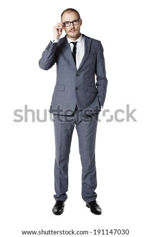 Portrait of thoughtful young man in gray suit. Isolated on white. - stock photo