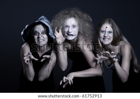portrait of three anger halloween personages over dark background - stock photo
