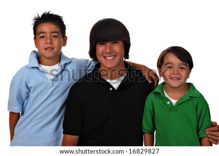 Portrait of three Asian-Caucasian brothers on white background