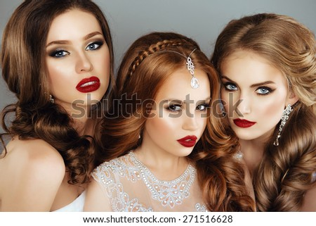 Portrait of three Beautiful Women with Fashion Make-Up and Hair. Close Up - stock photo