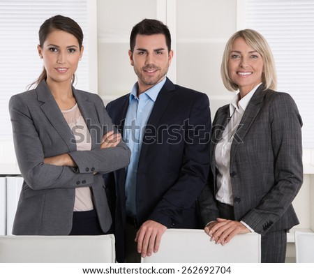 Portrait of three business people: man and woman in a team. - stock photo