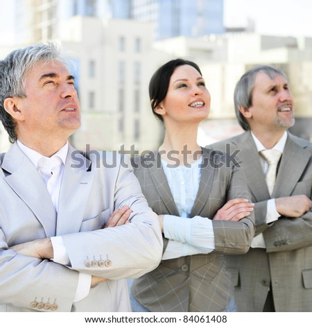 Portrait of three business people outside. Outside background.