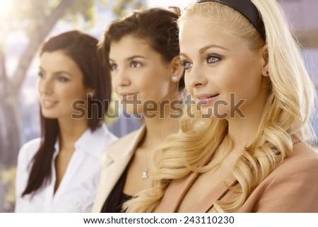 Portrait of three businesswomen in a row. Selective focus. - stock photo