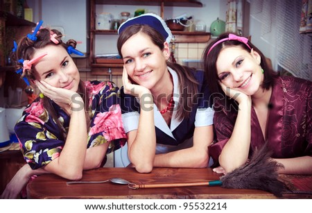 Portrait of three cheerful housewives - stock photo