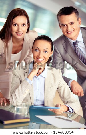 Portrait of three confident employees looking at camera