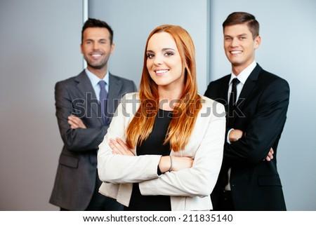 Portrait of three confident professionals - stock photo
