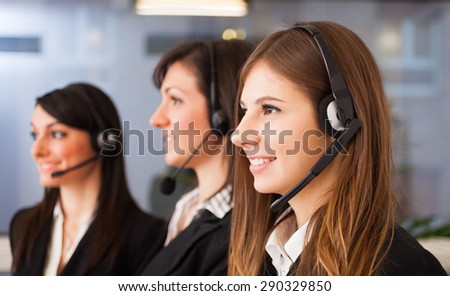 Portrait of three customer representatives at work - stock photo