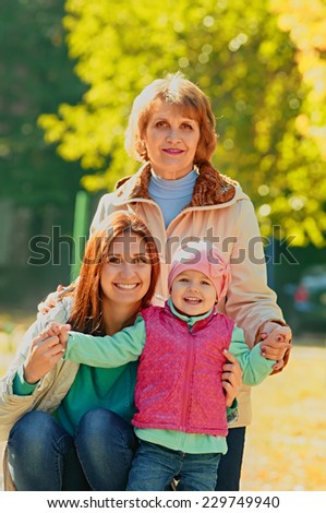 Portrait of three generations women in the autumn park