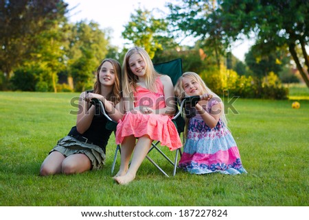 portrait of three girls outdoor  - stock photo