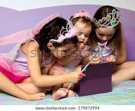 Portrait of three little girls dressed in princess - stock photo