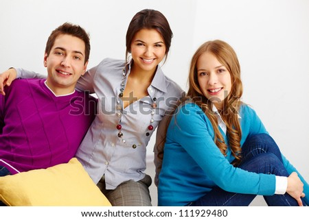 Portrait of three smart friends looking at camera on white background - stock photo