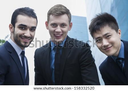 Portrait of three smiling businessmen - stock photo