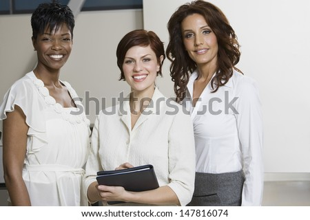 Portrait Of Three Smiling Multiethnic Businesswomen - stock photo