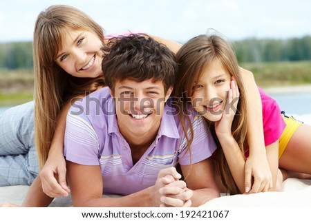 Portrait of three teenage friends looking at camera outside