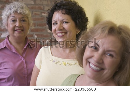 Portrait of three woman smiling - stock photo